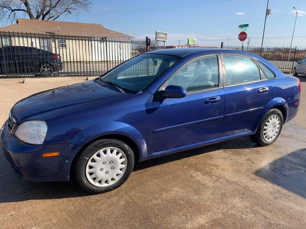 2006 BLUE /Gray Cloth Interior SUZUKI FORENZA (KL5JD56Z36K) with an 2.0L engine, 5-Speed Manual transmission, located at 2002 W Main St., Grand Prairie, TX, 75050, (972) 641-9598, 32.740414, -97.031143 - Photo #6
