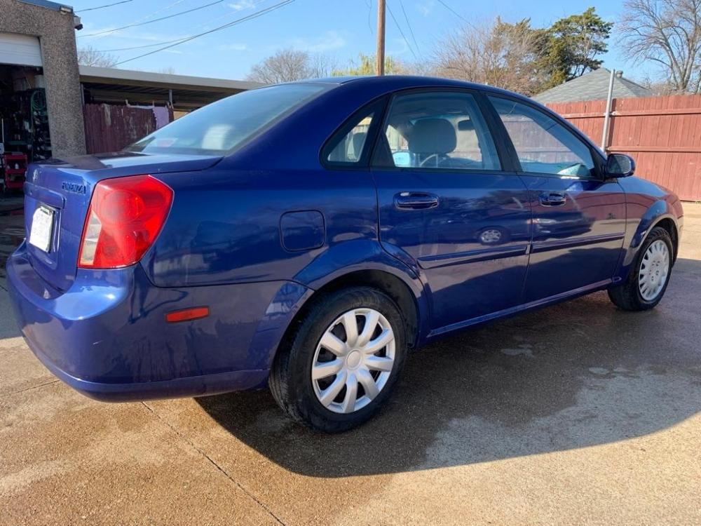 2006 BLUE /Gray Cloth Interior SUZUKI FORENZA (KL5JD56Z36K) with an 2.0L engine, 5-Speed Manual transmission, located at 2002 W Main St., Grand Prairie, TX, 75050, (972) 641-9598, 32.740414, -97.031143 - Photo #7
