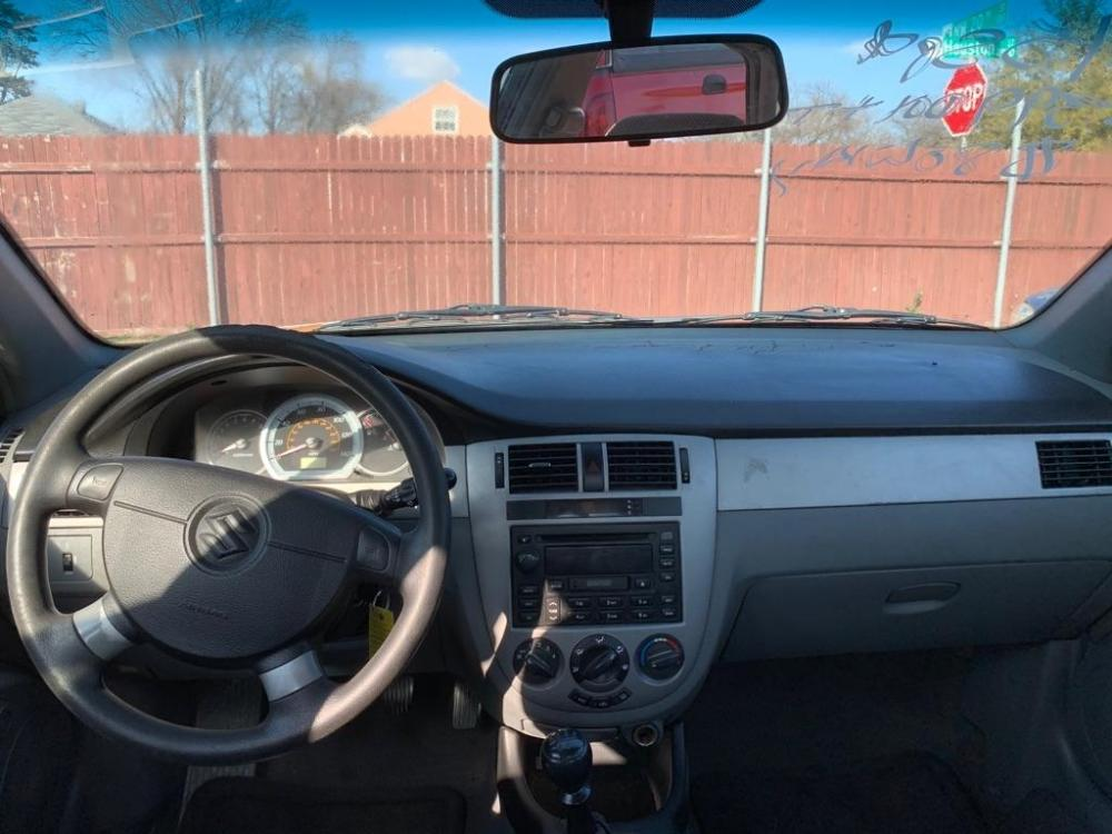 2006 BLUE /Gray Cloth Interior SUZUKI FORENZA (KL5JD56Z36K) with an 2.0L engine, 5-Speed Manual transmission, located at 2002 W Main St., Grand Prairie, TX, 75050, (972) 641-9598, 32.740414, -97.031143 - Photo #8