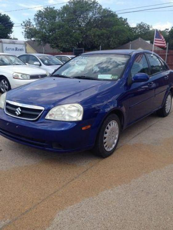 2006 BLUE /Gray Cloth Interior SUZUKI FORENZA (KL5JD56Z36K) with an 2.0L engine, 5-Speed Manual transmission, located at 2002 W Main St., Grand Prairie, TX, 75050, (972) 641-9598, 32.740414, -97.031143 - Photo #0