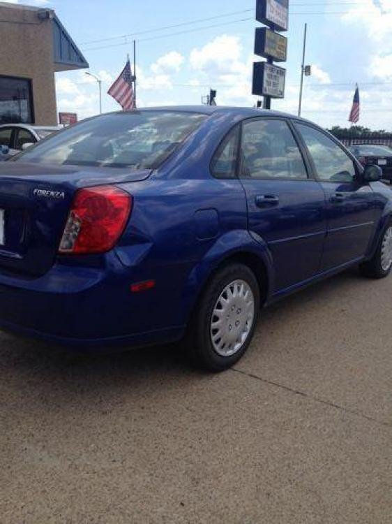 2006 BLUE /Gray Cloth Interior SUZUKI FORENZA (KL5JD56Z36K) with an 2.0L engine, 5-Speed Manual transmission, located at 2002 W Main St., Grand Prairie, TX, 75050, (972) 641-9598, 32.740414, -97.031143 - Photo #1