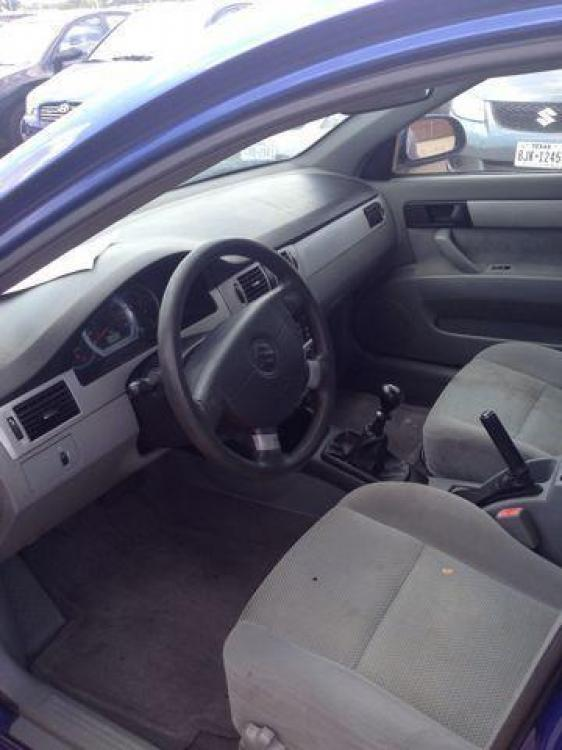 2006 BLUE /Gray Cloth Interior SUZUKI FORENZA (KL5JD56Z36K) with an 2.0L engine, 5-Speed Manual transmission, located at 2002 W Main St., Grand Prairie, TX, 75050, (972) 641-9598, 32.740414, -97.031143 - Photo #5
